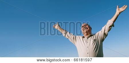 Joyful Senior Man Rejoicing In The Sunshine