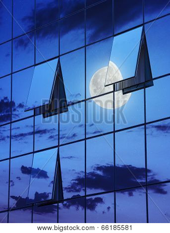 Reflection In Open Windows  Of  Skyscraper At Night