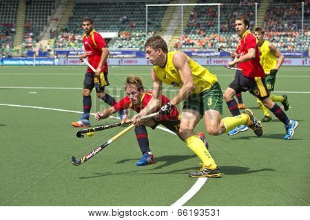 THE HAGUE, NETHERLANDS - JUNE 2: Simon Orchard (AUS) lifts the ball, entering the Spanish circle whilst Ramon Alegre (ESP) defends  during the Hockey World Cup. AUS beats SPA 3-0
