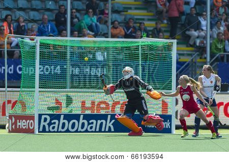 THE HAGUE, NETHERLANDS - JUNE 1: The ball shot by team USA on its way to the goal. The goalkeeper of England, Hinch, saves the ball during the Hockey World Cup. USA beats ENG 2-1