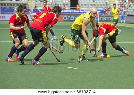 THE HAGUE, NETHERLANDS - JUNE 2: Glenn Turner (AUS) rushes through three Spanish defenders with the ball during the WOrld Cup Hockey match between Australia and Spain AUS beats SPA 3-0