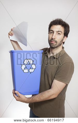 happy young man throw paper in blue basket