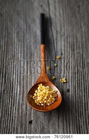 some beautiful sweet osmanthus on wooden spoon poster