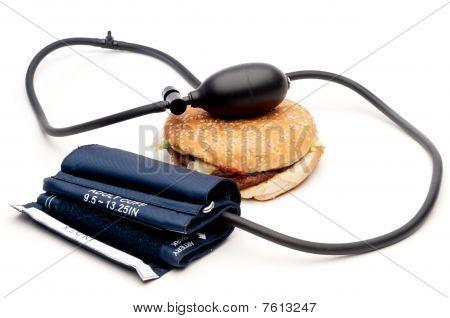 Blood Pressure Cuff And Hamburger On White - Health