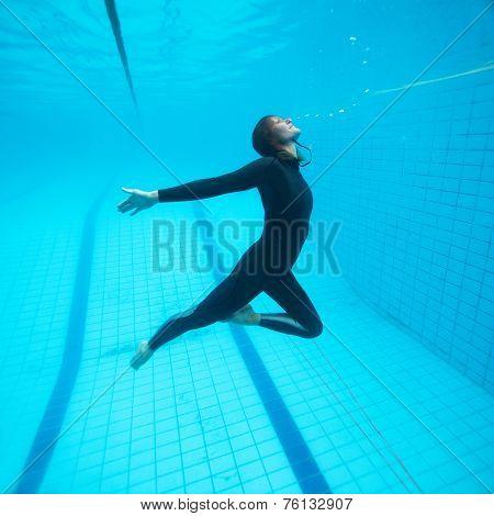 Female Diver Flying Underwater