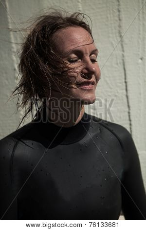 Attractive Smiling Female Swimmer With Eyes Closed