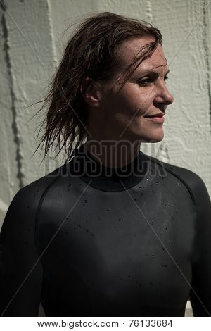 Attractive Female Swimmer With Wet Hair Wearing Wetsuit