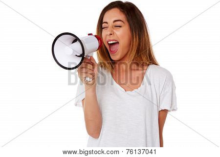 Angry Young Woman Yelling Into A Megaphone