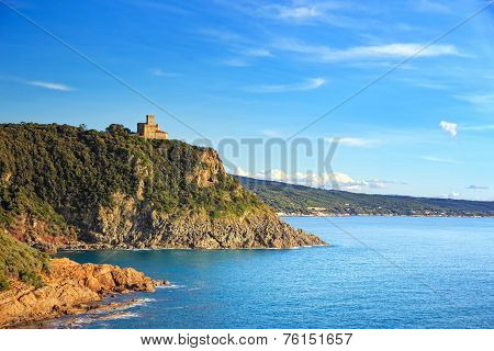 Cliff rock and building on the sea on sunset. Quercianella Tuscany riviera Italy Europe. poster