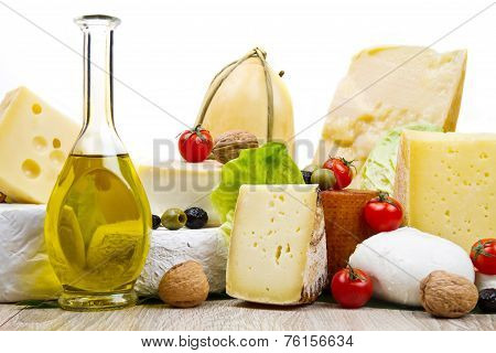 Various Types Of Cheese On White Wood