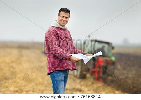 Farmer With Bank Forms