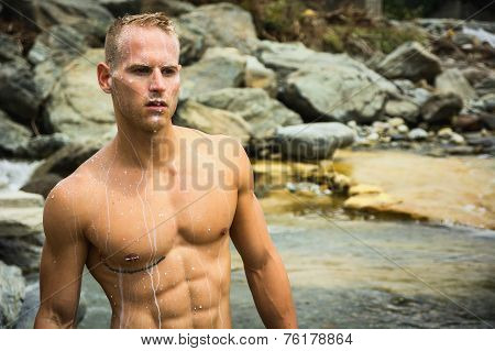Handsome Young Muscle Man Standing In Water Pond