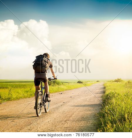 Man with Backpack Riding a Bicycle