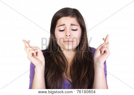 Brunette woman pray and hope with closed eyes isolated on white
