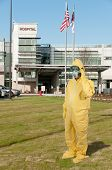 Man wearing a hazmat suit in the face of infectious disease poster