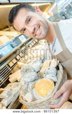 Man stocking the shelves in a cheese shop