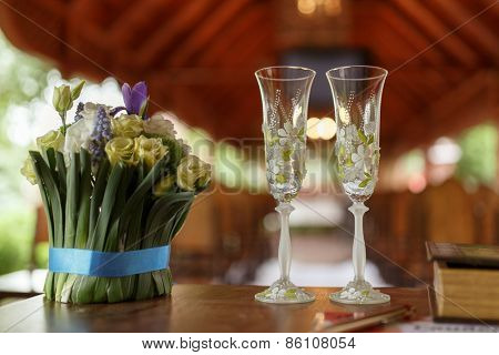 wedding glasses of champagne and bouquet of beautiful flowers: eustoma, Muscari, Crocus