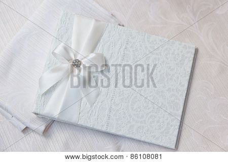 white wedding wish book decorated with bow and lace poster