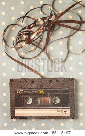 Audio tape cassette with subtracted out tape poster
