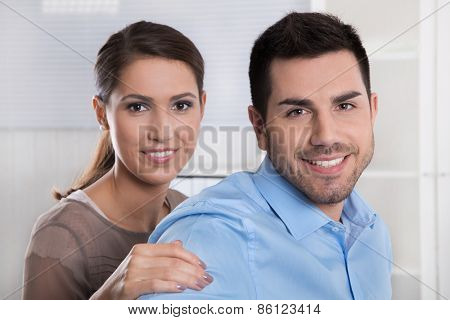Young married couple in the office making plans for retirement and future. poster