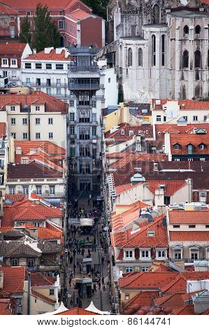 LISBON, PORTUGAL - OCT 2 2012 : Pedestrians stroll on the Rua Santa Justa in front of the Funicular