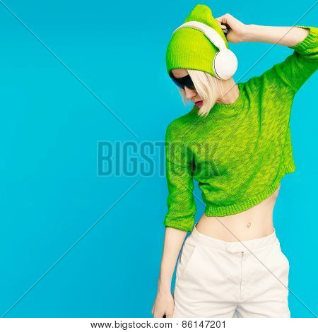 Glamorous Lada Dj In Bright Clothes Listening To Musik On Blue Background