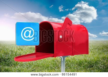 Red email postbox against sunny landscape poster
