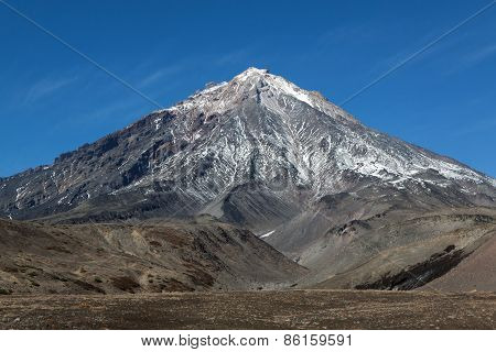 Beautiful mountain landscape: view on active Koryaksky Volcano (Koryak Volcano) on the Kamchatka Peninsula. Russia Far East. poster