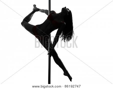 one  woman pole dancer dancing in silhouette studio isolated on white background nudity content