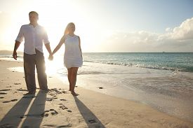 Couple Walking In Susnset Time