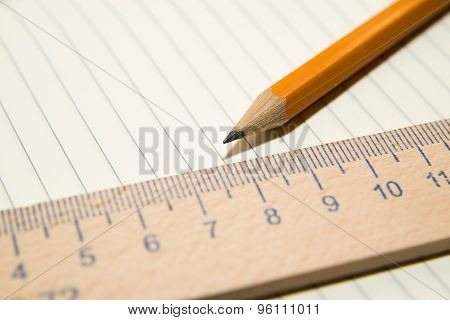 Notepads, Pencil And Wooden Ruler On The Old Tissue