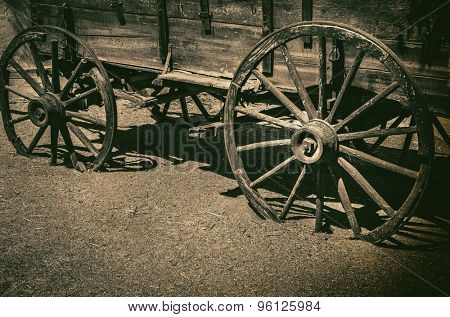 Old wagon wheel symbolic of American Wild West Cowboy concept