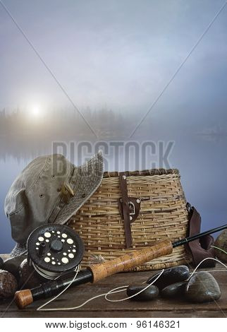 Fly rod with creel and equipment on wood table