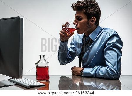 Young Drunk Caucasian Businessman With Bottle Of Alcohol