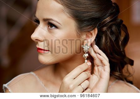 Woman Putting On Diamond Earrings. Caucasian Beauty Lady Trying And Shopping Jewelry.