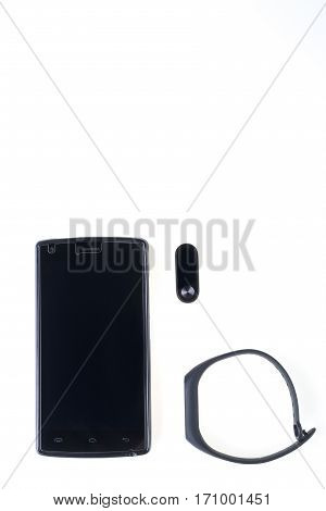 Black Fitness Bracelet And Smartphone Isolated On White Background.