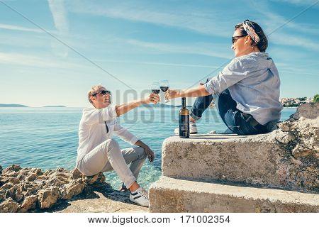 Couple in love have romantic date in blue lagune on Adriatic Sea
