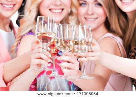 Closeup portrait of young happy women have party and drinking wine - isolated on white.