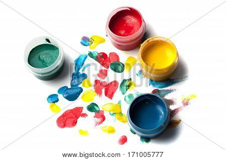 Colorful gouache, drops of paint on a white background