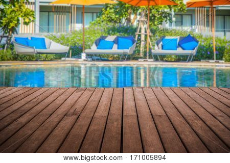 Perspective Empty Wooden Terrace With Swimmimg Pool Background
