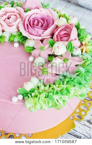 Birthday cake with flowers rose on white background.