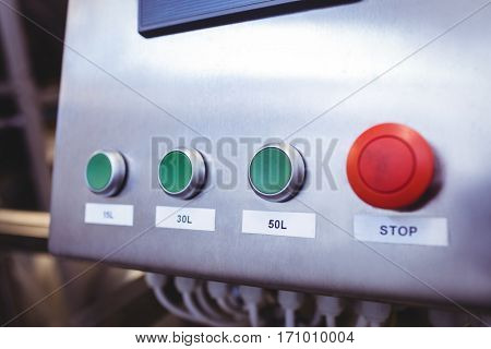 Close-up of stop button on machinery at brewery