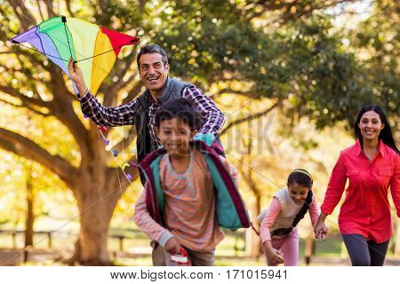 Happy family enjoying with kite at park