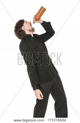 Young priest with bottle of alcohol isolated on white