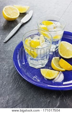 Water with lemons and ice. Well to quench your thirst in hot weather.