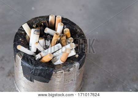Dirty Cigarette Butts In Ash Tray