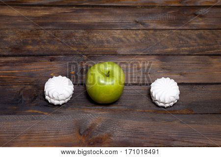 Fresh Green Apple And Two White Marshmallow