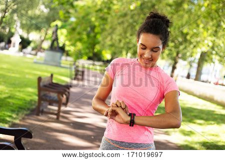 young woman checking her heartrate on her fitness watch