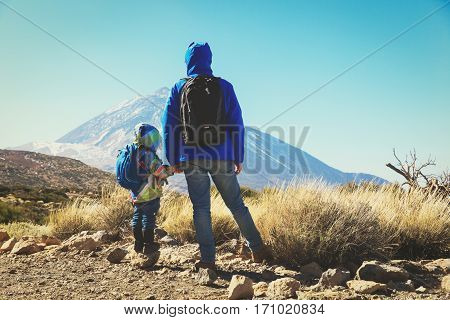 father with little daughter travel in scenic mountains
