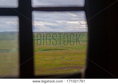 View of the tundra through the tent window
